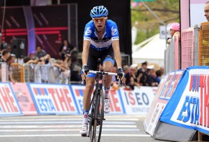 Canada's Ryder Hesjedal crosses the fini